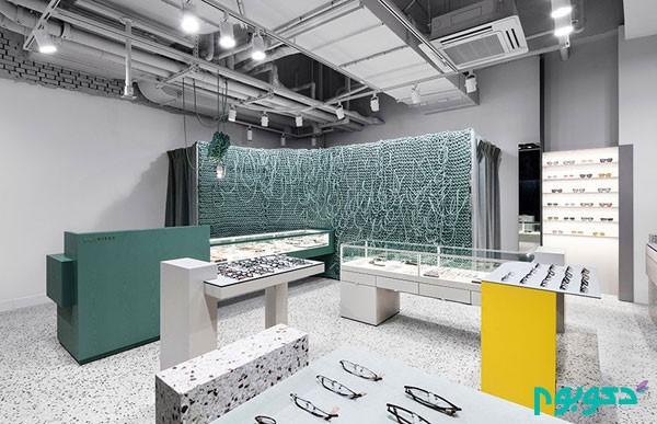 طراحی داخلی فروشگاه عینک با ایده دیوارهایی از سیم های بافته شده